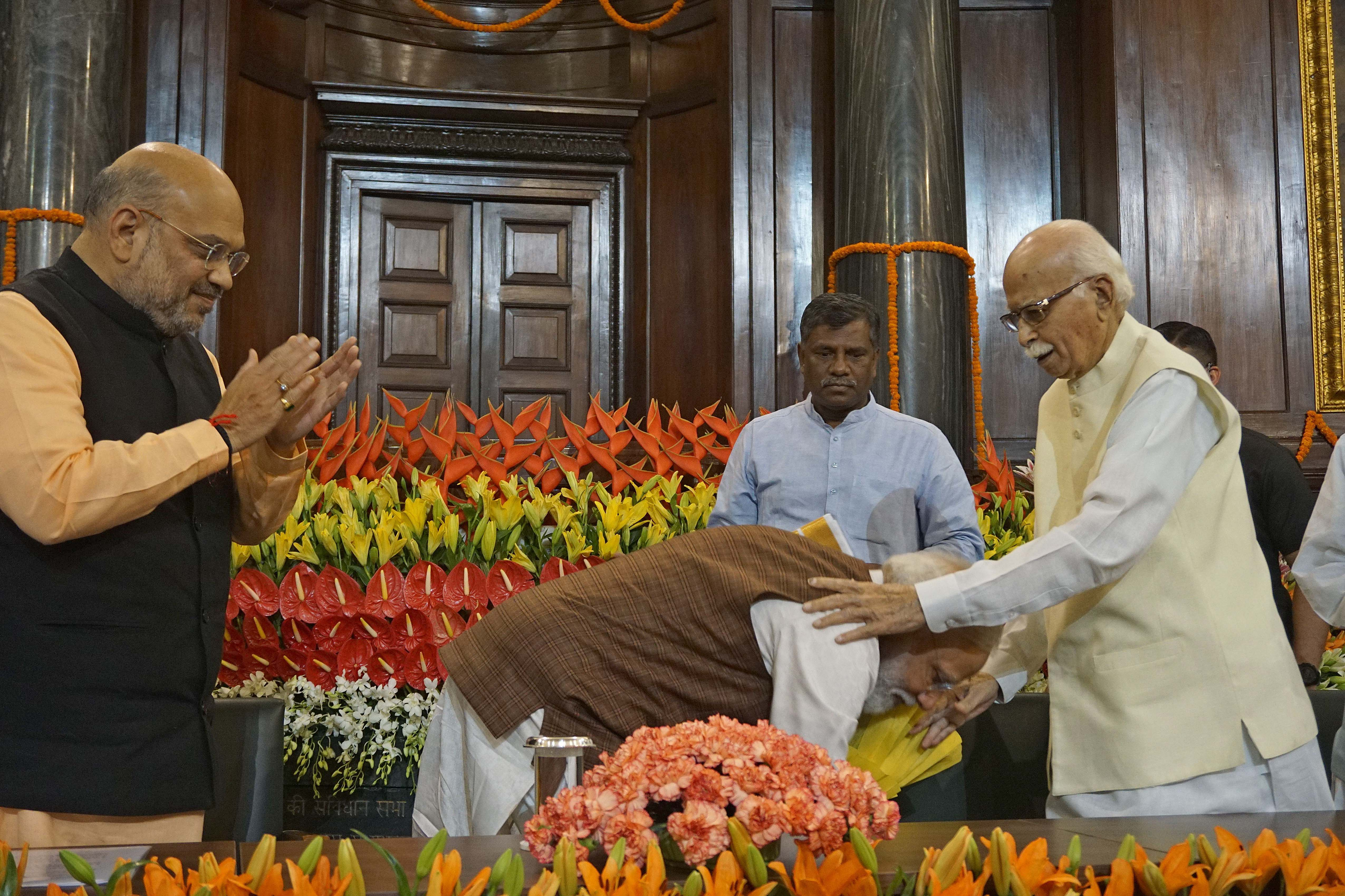 Prime Minister Narendra Modi takes blessing of veteran BJP leader L K Advani on being elected as leader of the NDA Parliamentary party,in New Delhi on Saturday. UNI