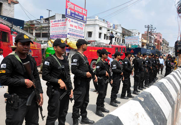 Cammondoess deployed to maintain law and order situation during muharram procession in old lucknow on Tuesday