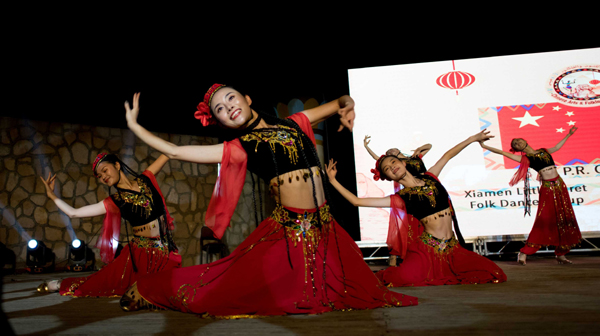 "ASWAN (EGYPT), Oct. 29 (Xinhua) -- Artists from China's Xiamen Little Egret Folk Dance Group perform during the Afro-Chinese Arts and Folklore Festival in Aswan, Egypt, on Oct. 28, 2019. At ancient Philae Temple on an island surrounded by the Nile River waters and rocky hills in Upper Egypt's Province of Aswan, the ongoing fourth edition of the Afro-Chinese Arts and Folklore Festival has kicked off to boost interaction between troupes from 30 states through art and culture. TO GO WITH ""Feature: Cultural interaction manifested in 4th Afro-Chinese folklore festival in Egypt"" Xinhua/UNI PHOTO-4F"