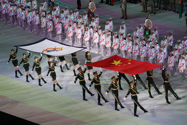 WUHAN, Oct. 18, 2019 (Xinhua) -- The Chinese national flag and International Military Sports Council (CISM) flag are seen during the opening ceremony of the 7th International Military Sports Council (CISM) Military World Games in Wuhan, capital of central China's Hubei Province, Oct. 18, 2019. Xinhua/UNI PHOTO-14F