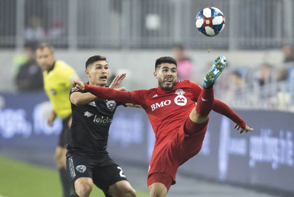 TORONTO, Oct. 20, 2019 (Xinhua) -- Alejandro Pozuelo (R) of Toronto FC vies with Joseph Mora of D.C. United during the first round match of the 2019 Major League Soccer (MLS) Cup Playoffs between D.C. United and Toronto FC at BMO Field in Toronto, Canada, Oct. 19, 2019. (Photo by Zou Zheng/Xinhua/UNI PHOTO-1F