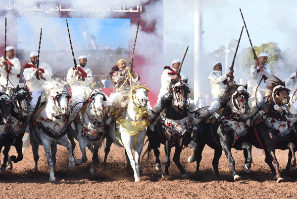 EL JADIDA (MOROCCO), Oct. 19, 2019 (Xinhua) -- Moroccan men in traditional costumes ride horses during a Fantasia horse competition at the 12th edition of the Salon du Cheval, Morocco's flagship horse exhibition, in El Jadida, Morocco, on Oct. 18, 2019. (Photo by Chadi/Xinhua/UNI PHOTO-4F