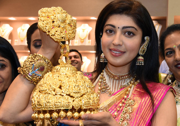 Film actress Pranith Subhash display jewellery during inauguration of Jewels of India