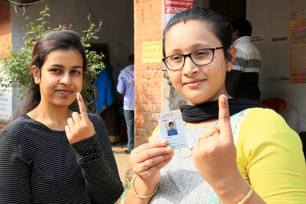 PALAMU, NOV 30 (UNI):-Ladies showing their inked finger after casting his vote during during 1st phase of Assembly Election at, in Palamu on Saturday. UNI PHOTO-54U