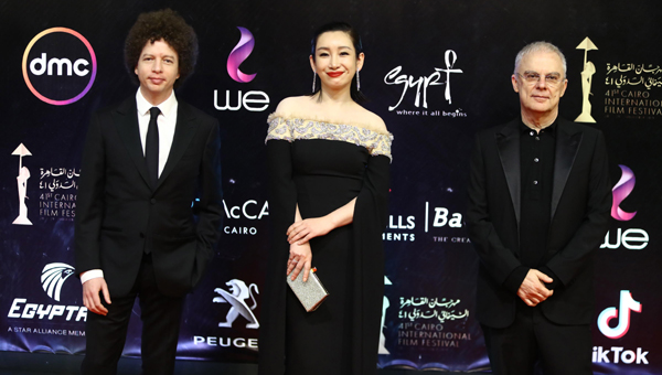 CAIRO,NOV 21 (Xinhua) -- Chinese actress Qin Hailu (C) attends Cairo International Film Festival in Cairo, Egypt, on Nov. 20, 2019. The 41st edition of Cairo International Film Festival (CIFF) kicked off on Wednesday evening in a festive red carpet ceremony at Egypt's Cairo Opera House, gathering movie stars and filmmakers from different parts of the world. Xinhua/UNI PHOPTO-2F