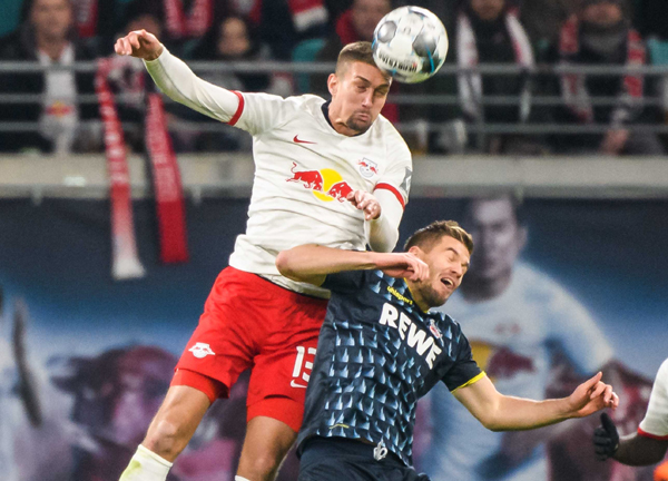 LEIPZIG, Nov. 24 (Xinhua) -- Stefan Ilsanker (top) of Leipzig vies for header with Simon Terodde of Koeln during a German Bundesliga match between RB Leipzig and 1.FC Koeln in Leipzig, Germany, on Nov. 23, 2019. Xinhua/UNI PHOTO-1F