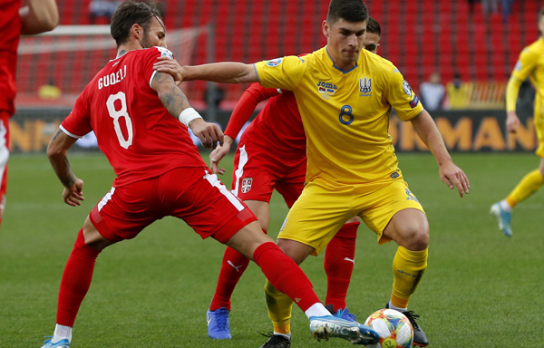 BELGRADE, Nov. 18 (Xinhua) -- Ukraine's Ruslan Malinovskiy (L) vies with Serbia's Nemanja Gudelj during the group B match between Serbia and Ukraine at the UEFA Euro 2020 qualifier in Belgrade, Serbia on Nov. 17, 2019. Xinhua/UNI PHOTO-3F