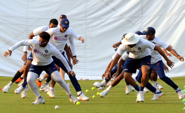 KOLKATA NOV 20 (UNI ) Indian players warming up rigorously at Eden Gardens led by skipper Virat Kohli on the eve of the historic pink ball test in Kolkata today. UNI PHOTO CAL 7