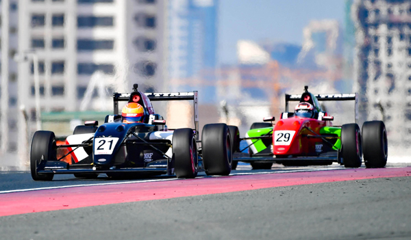 DUBAI, NOV 23 (UNI):-Indian-American Yuven Sundaramoorthy (29) and Joshua Mason of UK (21) locked in the battle during the FIA-approved MRF Challenge International Series at the Dubai Autodrome on Saturday. UNI PHOTO CF 1 U