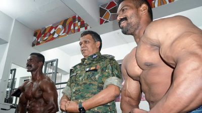 THIRUVANANTHAPURAM, NOV 25 (UNI)- Kerala Director General of Police (DGP) Lokanath Behera (C) being pose for Muscle ,during the Renovation of GYM facility for Kerala police in Thiruvananthapuram on Monday.UNI PHOTO-94U