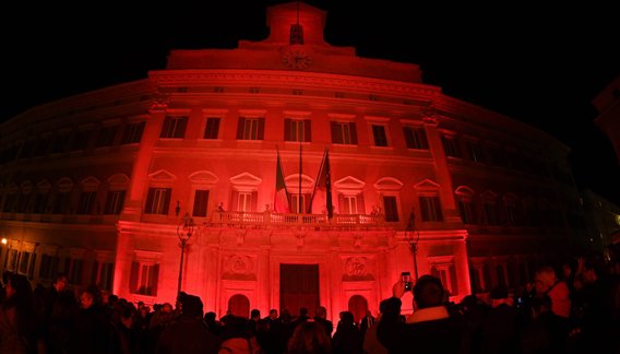 ROME, Nov. 26 (Xinhua) -- People gather in front of the Palazzo Montecitorio illuminated in red to mark the International Day for the Elimination of Violence Against Women in Rome, Italy, on Nov. 25, 2019. Several events were held in Italy to mark the International Day for the Elimination of Violence Against Women, which was marked worldwide on Monday. Xinhua/ UNI PHOTO-3F