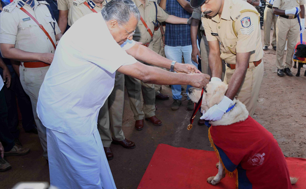 THIRUVANANTHAPURAM, NOV 1 (UNI)- Kerala Chief Minister Pinarayi Vijayan honouring a police dog during foundation day celebration of Kerala in Thiruvananthapuram on Friday.UNI PHOTO-49u
