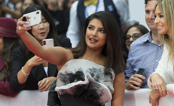 "TORONTO, Sept. 13, 2019 (Xinhua) -- Actress Priyanka Chopra Jonas (C) takes selfies with fans before the world premiere of the film ""The Sky Is Pink"" at Roy Thomson Hall during the 2019 Toronto International Film Festival (TIFF) in Toronto, Canada, on Sept. 13, 2019. (Photo by Zou Zheng/Xinhua/IANS)"