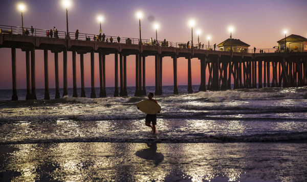 ORANGE COUNTY (U.S.), Nov. 4 (Xinhua) -- A surfer is seen during sunset on the Huntington Beach, California, the United States, on Nov. 2, 2019. Xinhua/UNI PHOTO-4F