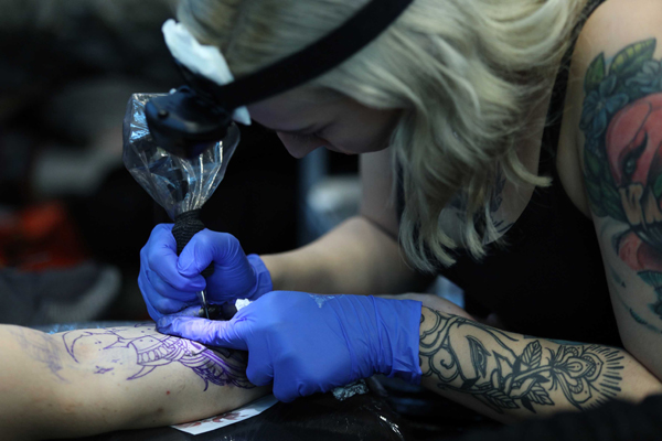 RIJEKA (CROATIA), Nov. 23 (Xinhua) -- A tattoo artist works on a design during the 9th Rijeka Tatto Expo in Rijeka, Croatia, on Nov. 22, 2019. The 9th Rijeka Tatto Expo kicked off on Friday in Rijeka of Croatia and will last until Nov. 24. (Nel Pavletic/Pixsell via Xinhua/UNI PHOTO-4F