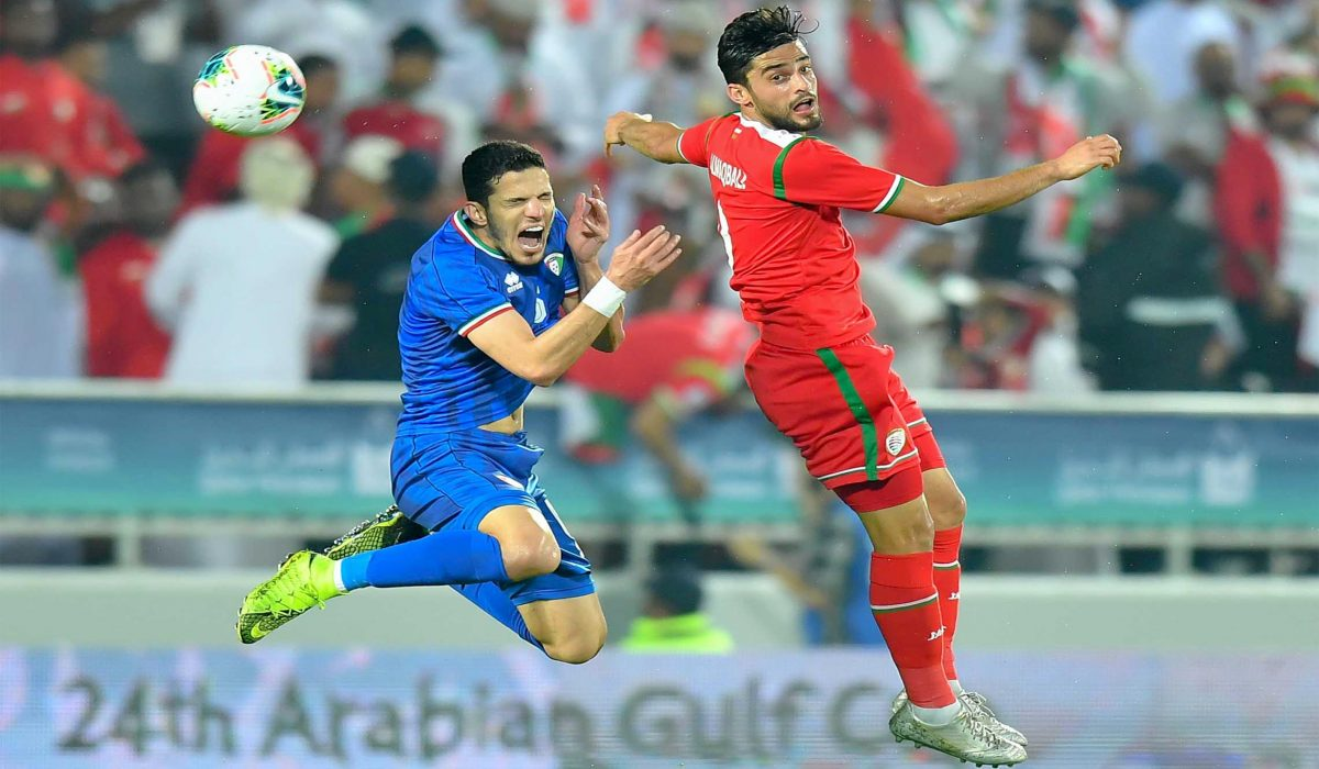 DOHA, Dec. 1, 2019 (Xinhua) -- Abdulaziz AL Maqbali (R) of Oman vies with Siltan Alenezi of Kuwait during the 24th Arabian Gulf Cup 2019 Group B football match at the Abdullah bin Khalifa Stadium in Doha, capital of Qatar, Nov. 30, 2019. Xinhua/UNI PHOTO-4F