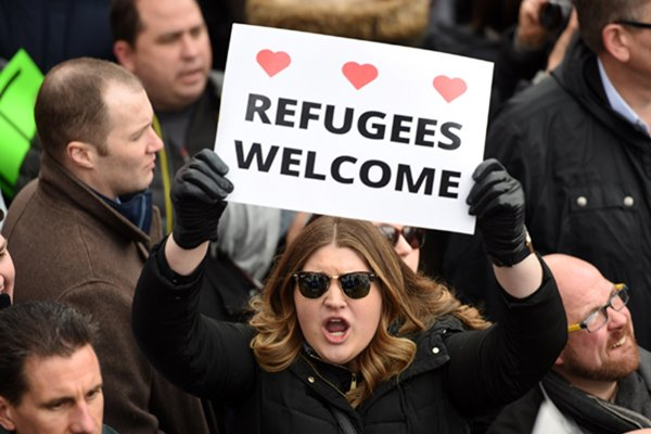 NEW YORK, Jan. 19, 2018 (Xinhua) -- File photo taken on Jan. 29, 2017 shows demonstrators participate in a protest against U.S. President Donald Trump's executive order temporarily barring all refugees and seven Mideast and North African countries' citizens from entry into the U.S. in front of the White House in Washington D.C., the Unite States. Protesters rallied in front of the White House on Sunday while demonstrations continued across more than 30 American airports after U.S. President Donald Trump signed an executive order temporarily barring all refugees and seven Mideast and North African countries' citizens from entry into the United States.Jan. 20, 2018 reaches one-year mark for Donald Trump as the 45th president of the United States. One year into U.S. President Donald Trump's presidency, the uncertainties and anxieties over his unconventional playbook appear to have not diminished. As he seeks to implement his campaign promises, which seem controversial and even unacceptable to many, rifts, feuds and controversies dogged the year and 2018 would probably not be any different. (Xinhua/Yin Bogu/IANS)