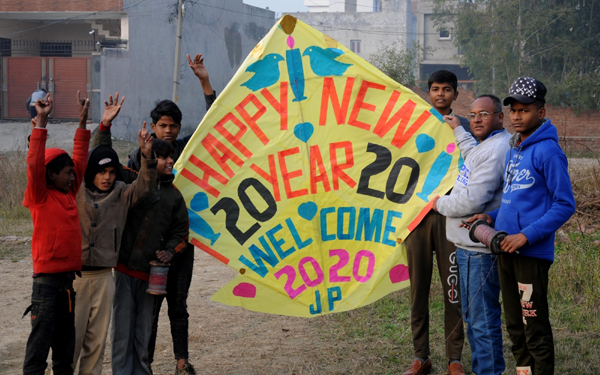 Amritsar: A kite-maker shows new year-themed kites to bid adieu to the outgoing year 2019 and to welcome the upcoming year 2020, at his workshop in Amritsar on Dec 31, 2019. (Photo: IANS)