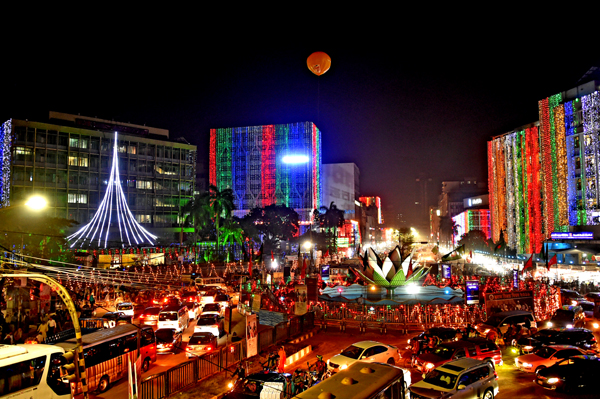 (191216) -- DHAKA, Dec. 16, 2019 (Xinhua) -- Photo taken on Dec. 15 shows colourful lights in Bangladesh capital Dhaka's Motijheel commercial area on the eve of the 49th Victory Day. Bangladesh on Monday celebrated its 49th victory day with due solemnity and rich tributes paid to the martyrs of the Liberation War of 1971. (Str/Xinhua)
