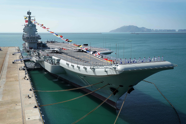 SANYA, Dec. 27, 2019 (Xinhua) -- Photo taken on Dec. 17, 2019 shows the Shandong aircraft carrier at a naval port in Sanya, south China's Hainan Province. China's first domestically built aircraft carrier, the Shandong, was delivered to the People's Liberation Army (PLA) Navy and placed in active service on Dec. 17 at a naval port in Sanya. The new aircraft carrier, named after Shandong Province in east China, was given the hull number 17. (Xinhua/Li Gang/IANS)