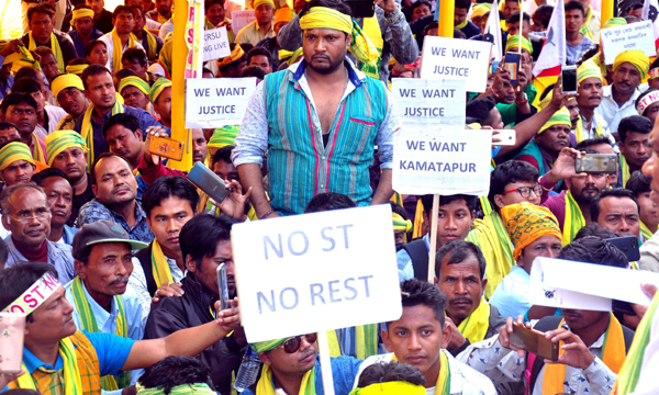 GUWAHATI, DEC, 3, (UNI):-Members of AKRSU staging a dharna on their demand for ST status in Guwahati on Tuesday.UNI PHOTO-38U
