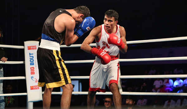New Delhi: Gujarat Giants' Chirag (R) in action against Punjab Panthers' A Khalakov (L) during the Big Bout Indian Boxing League at the Indira Gandhi Indoor Stadium Complex in New Delhi on Dec 10, 2019. (Photo: IANS)