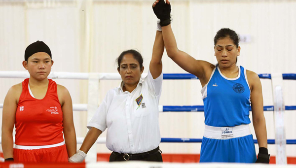KANNUR, DEC 3 (UNI):- Referee lifting the hand of Aradhana Patel of Uttar Pradesh as she beat Indu Rani of Rajasthan in the 60-64 category preliminary round of the fourth Elite Women's National Boxing Championship-2019, in Kannur on Tuesday.UNI PHOTO-55U