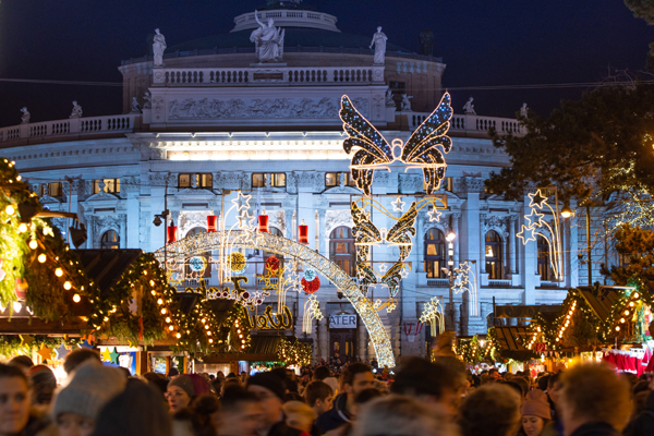 (191215) -- VIENNA, Dec. 15, 2019 (Xinhua) -- Photo taken on Dec. 15, 2019 shows the holiday illumination at the Christmas market on the Rathausplatz in Vienna, Austria. As one of the oldest and most famous Christmas markets in Europe, the Christmas market at Rathausplatz in Vienna attracts a large number of local residents and tourists every year during the holiday season. (Xinhua/Guo Chen)