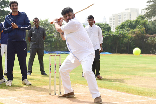 Bengaluru: Former Karnataka Minister D. K. Shivakumar plays cricket during the inauguration of Media Cricket Tournament at Central College Grounds of PES University, in Bengaluru on Dec 21, 2019. (Photo: IANS)