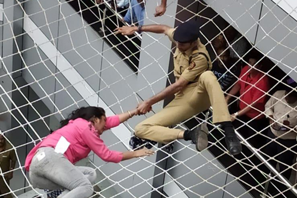 Mumbai: The woman who tried to commit suicide by jumping from the fourth floor of Mantralaya, being rescued after her fatal fall was prevented by the protective wire net, in Mumbai on Dec 13, 2019. (Photo: IANS)