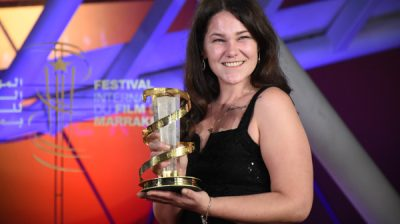 (191208) -- MARRAKECH, Dec. 8, 2019 (Xinhua) -- British actress Roxanne Scrimshaw poses with her trophy for the Best Actress award at the closing ceremony of the 18th Marrakech International Film Festival in Marrakech, Morocco, Dec. 7, 2019. (Photo by Chadi/Xinhua)