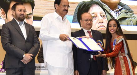 New Delhi: Vice President M. Venkaiah Naidu presents the Rajat Kamal Award to child actress Prapti Mehta for the Special Jury Award: Hellaro, at the 66th National Film Awards function, in New Delhi on Dec 23, 2019. Also seen Union Minister for Environment, Forest & Climate Change, Information & Broadcasting and Heavy Industries and Public Enterprise Prakash Javadekar and Ministry of Information & Broadcasting Secretary Ravi Mittal. (Photo: IANS/PIB)