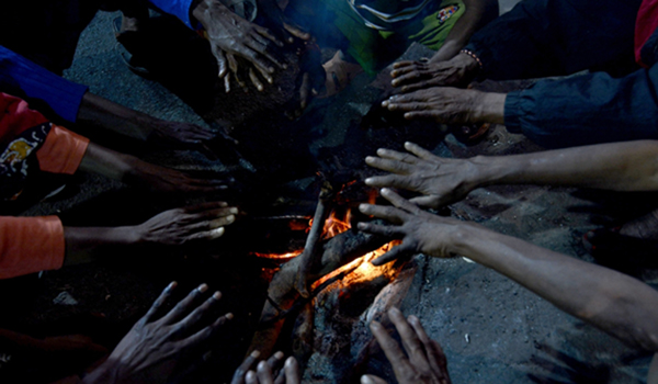 Kolkata: People warm themselves around the fire on a chilly winter evening in Kolkata on Dec 27, 2019. (Photo: Kuntal Chakrabarty/IANS)