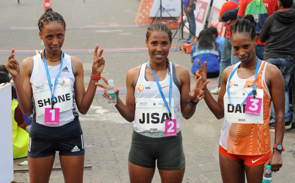 Kolkata: Ethiopian Guteni Shone (1st position) (L) Ethiopian duo Betesfa Getahun (2nd position) (L) and Bayelign Yegsaw (3rd position) (R) during the Tata Steel 25K Elite run, in Kolkata on Dec 15, 2019. (Photo: IANS)
