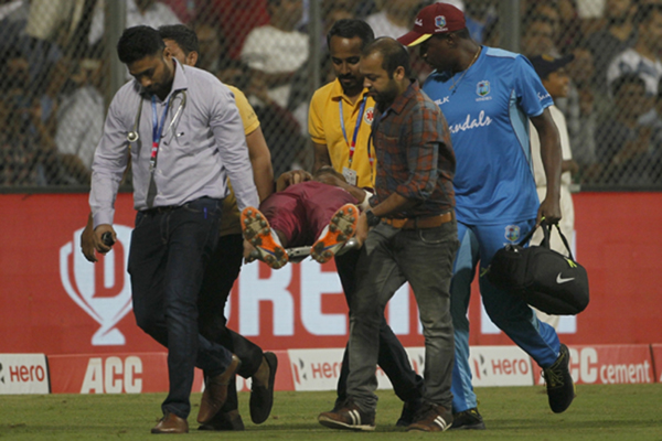 Mumbai: Evin Lewis of West Indies being taken for medical examination and treatment after he got injured during the third T20I match between India and West Indies at Wankhede Stadium in Mumbai on Dec 11, 2019. (Photo: Surjeet Yadav/IANS)