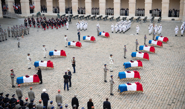 PARIS, Dec 3 (Xinhua) -- People attend a tribute ceremony for the fallen servicemen at the Les Invalides in Paris, France, on Dec. 2, 2019. France held the ceremony here on Monday to pay tribute to 13 soldiers who died in a helicopter accident in Mali a week ago. Xinhua/ UNI PHOTO-3F