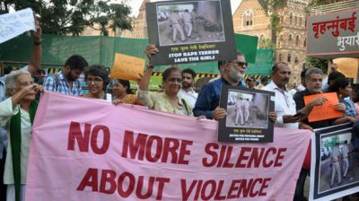 MUMBAI, DEC 02 (UNI) - People from Various NGO'S protest for Women's Safety & Justice outside CST station,in Mumbai on Monday. UNI PHOTO-88U
