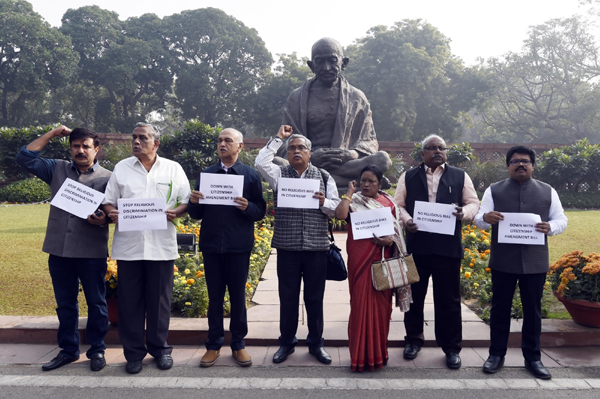 New Delhi: Left Parties protest against Citizenship (Amendment) Bill, or CAB in front of Mahatma Gandhi statue at the Parliament in New Delhi on Dec 10, 2019. (Photo: IANS)