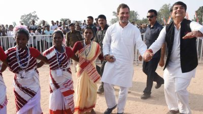 Rahul Gandhi dancing with tribal youths at an election campaign rally