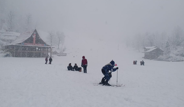 Manali: The Solang ski slopes near Manali wrapped in a thick blanket of snow, bringing cheers on the faces of skiers after the picturesque tourist spot in Himachal Pradesh experienced this season's first snowfall, on Dec 12, 2019. (Photo: IANS)