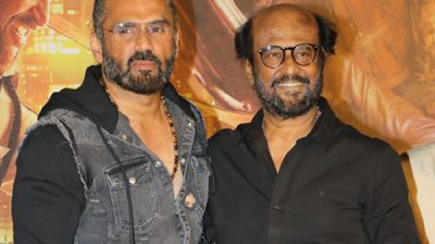 "Mumbai: Actors Rajinikanth and Sunil Shetty at the trailer launch of their upcoming film ""Darbar"" in Mumbai on Dec 16, 2019. (Photo: IANS)"