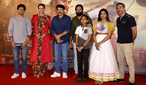 MUMBAI, DEC 5 (UNI) - South Indian actors Mammootty, Unni Mukundan and Prachi Tehlan with star cast pose for photos during the trailer launch of their upcoming film Mamangam: History of the Brave, in Mumbai on Wednesday. UNI PHOTO-9U