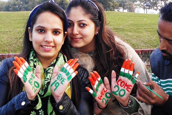 Amritsar: Girls with their hands painted in tricolor, bid goodbye to the year 2019 and welcome the upcoming year 2020, in Amritsar on Dec 30, 2019. (Photo: IANS)
