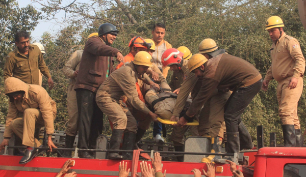 New Delhi: The body of a firefighter who succumbed to injuries after he got trapped under the debris for about 9 hours at a battery manufacturing factory which caught fire, in Outer Delhi's Mundka area on Jan 2, 2020. Balyan was a resident of Shahdhra and he was the last man brought out from the collapsed building. After nine hour long rescue operation by the Delhi Fire Service and the NDRF, 18 people including 15 firefighters have been rescued (Photo: IANS)