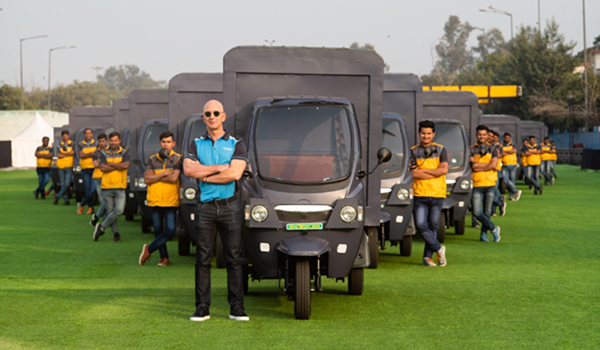 Bengaluru: Amazon founder Jeff Bezos flanked by the company's Indian delivery boys and electric vehicles during his recent visit. E-commerce giant Amazon India will deploy 10,000 electric vehicles (EVs) in its delivery fleet by 2025, the company said on Monday. (Photo: IANS)