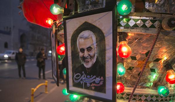 (200103) -- TEHRAN, Jan. 3, 2020 (Xinhua) -- A poster of top Iranian commander Qasem Soleimani is seen on a street in Tehran, Iran, on Jan. 3, 2020. An attack near Baghdad International Airport on Friday has killed top Iranian commander Qasem Soleimani, and Abu Mahdi al-Muhamdis, the deputy top leader of Iraq's paramilitary Hashd Shaabi forces. (Photo by Ahmad Halabisaz/Xinhua)