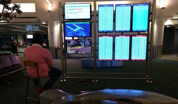 Man takes over airport monitor to play video game