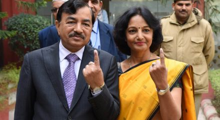 New Delhi: Election Commissioner Sushil Chandra and his wife show their inked fingers after casting their votes for Delhi Assembly elections 2020 at Wonderland Kids School in Delhi's New Moti Bagh on Feb 8, 2020. (Photo: IANS/PIB)