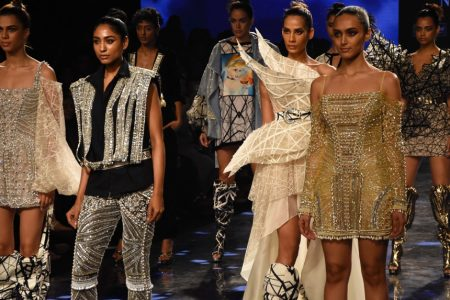 Models showcase the creation of fashion designer Swapnil Shinde