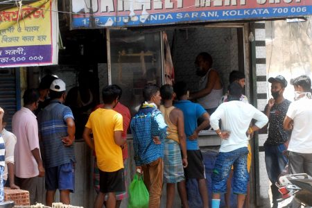 People violate social distancing at meat shop during the lockdown in Kolkata